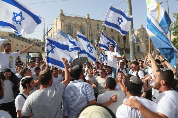 Cheering crowds gathered in Jerusalem and Tel Aviv waving flags and banners, celebrating Israel's new coalition government that has ousted Benjamin Netanyahu's 12-year rule.